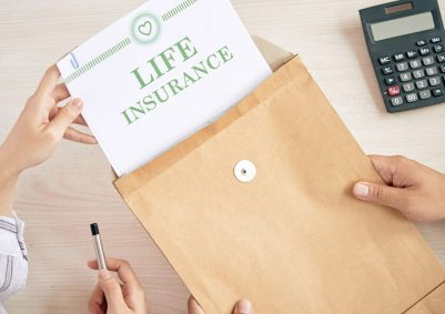 Woman removes document titled 'LIFE INSURANCE' from brown envelope