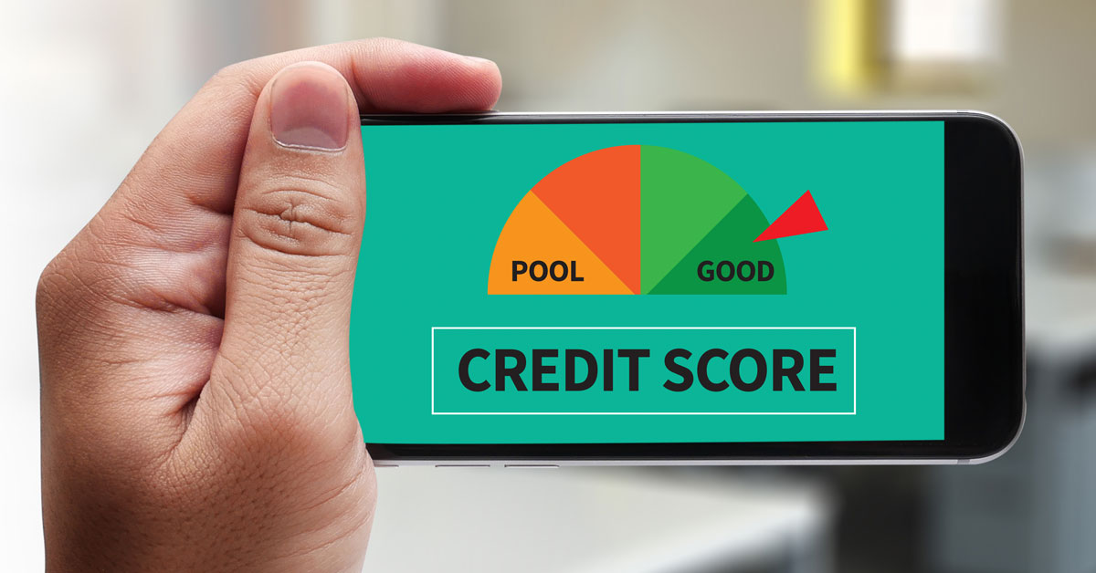 Close-up of man's hand holding smartphone that shows a 'Good' credit rating